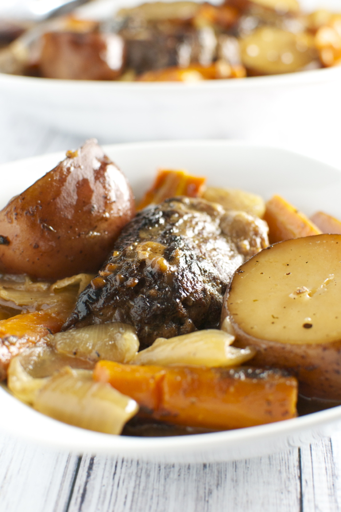Red Wine Slow Cooker Short Ribs With Potatoes Carrots And Onion Stuck On Sweet