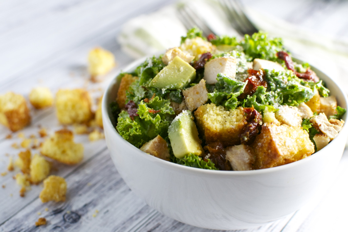 Kale Caesar Salad with Chicken, Sun Dried Tomatoes, Avocado, and Cornbread Croutons | stuckonsweet.com