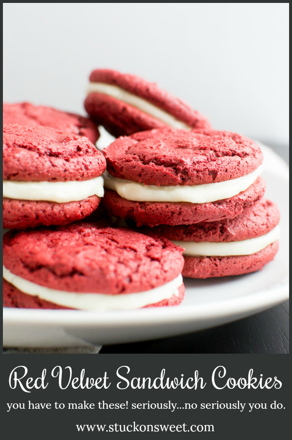 Chewy red velvet cookies are slathered with cream cheese frosting. I mean come on! These are so good! #stuckonsweet #cookies #recipe #redvelvet