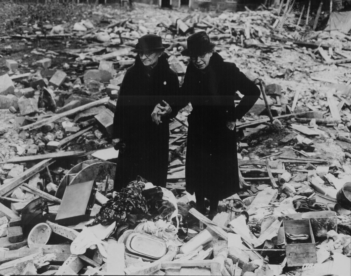 Elderly Women At An Air Raid Site In