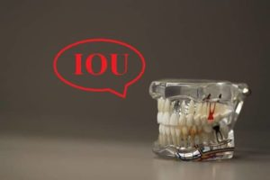 dentures-cup-saying-iou