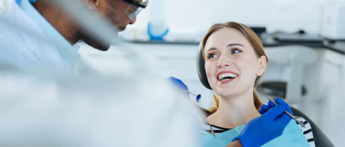 male-dentist-with-female-patient