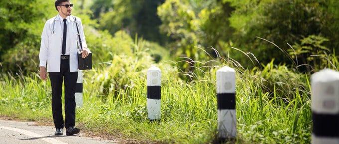 male-doctor-walking-side-rural-road