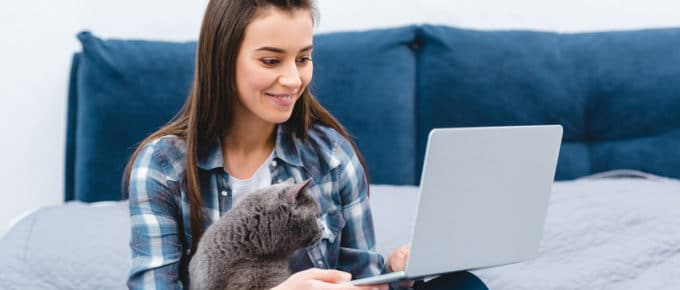young-woman-laptop-cat-sitting-lap