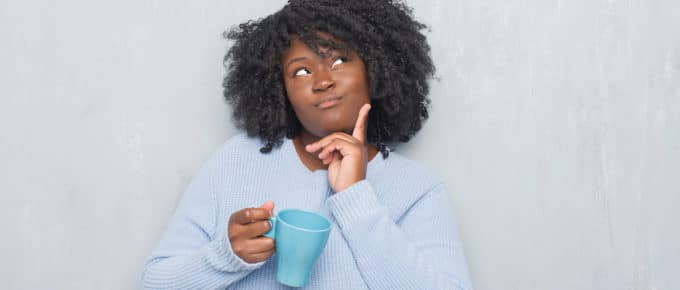 woman-thinking-holding-cup