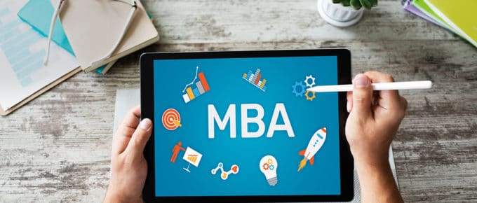 man's-hands-holding-tablet-says-mba