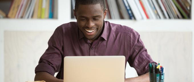 man-smiling-pleased-laptop