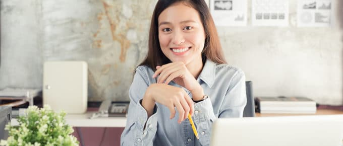 young-businesswoman-smiling-laptop