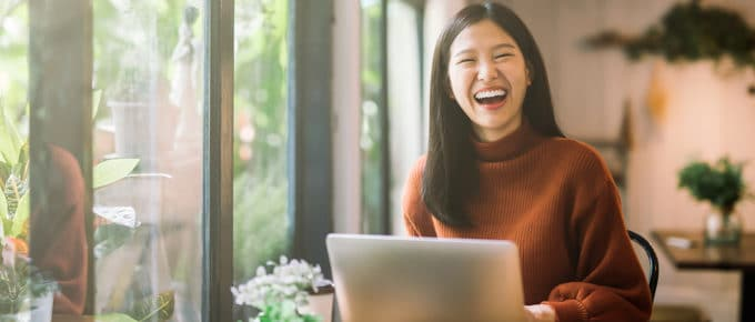 happy-laughing-young-woman-laptop