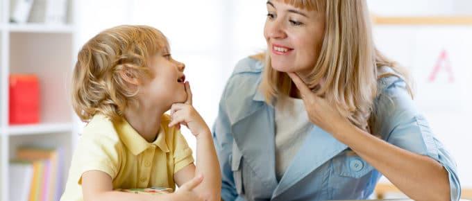 speech-language-pathologist-helping-little-boy-therapist-office