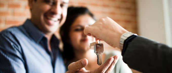 couple-taking-keys-from-realtor-new-home