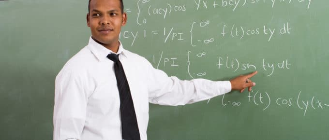 male-teacher-pointing-blackboard-math-equations