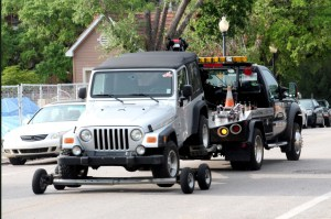 The vehicle of a student involved in a self-inflicted gunshot wound was towed away from the scene on Championship Boulevard near the district May 2.