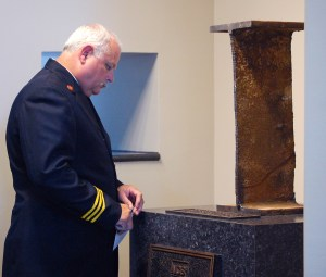 A firefighter pays his respects at the 9/11 monument on Wednesday morning. The 111-pound piece of steel from the World Trade Center was donated to Southern Miss at the dedication ceremony. Susan Broadbridge/Printz
