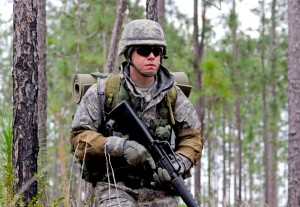 USM sophomore and Army ROTC cadet Dylan Paul performs a squad mission during an STX lane Saturday, March 2 at Camp Shelby.  Jamie Gominger/Printz Archives