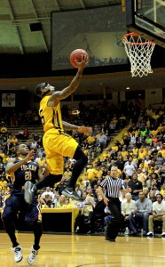 Senior Neil Watson goes for a layup during the first NIT game against The University of Toledo at Reed-Green Coliseum Wednesday night. Becky Vu/Printz
