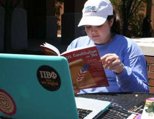 Senior Emily Booth, an elementary education and special education double major, reads about the Unites States Constitution.  Booth's bucket list wish is to move to Washington, D.C. and work in politics. Jillian Rodriguez/Printz