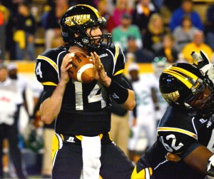 Quarterback Nick Mullens holds the ball before making his throw at the homecoming football game against North Texas Oct. 26, 2013.  Printz Archives