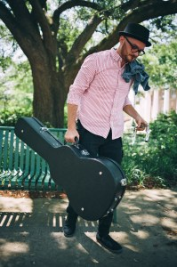 "Jeremiah Stricklin meanders through Southern Miss campus, guitar and harmonica in hand. Oh, Jeremiah's first album is ""Tall Tales and Tiny Fables"" and ""Our Very Own Kingdom"" will be the band's second album.  Kate Dearman/Printz"