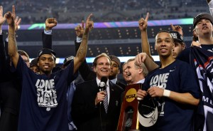 Connecticut Huskies guard Ryan Boatright (left) and guard Shabazz Napier (right) celebrate as they are presented with the national championship trophy after the championship game of the Final Four in the 2014 NCAA Men's Division I Championship tournament against the Kentucky Wildcats at AT&T Stadium. Robert Deutsch/USA Today