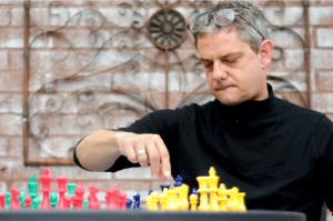 Chuck Carruth of Petal, Miss., moves pieces in Megiddo Chess. Photo by Mary Alice Truitt.