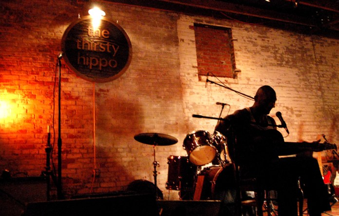 Cedric Burnside kept the audience swinging and dancing with his bluesy tunes Friday night. This grandson of R.L. Burnside has become a regular player at The Thirsty Hippo in Downtown Hattiesburg. | Photo by Mary Sergeant