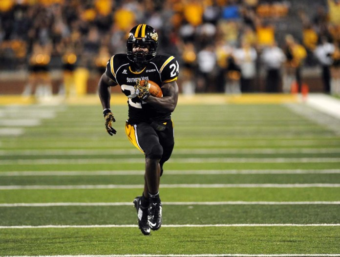 Running Back George Payne runs to the end zone as Southern Miss scores a touchdown against Appalachian State Saturday night. The final score set the Golden Eagles with a victory, 21-20. -Susan Broadbridge