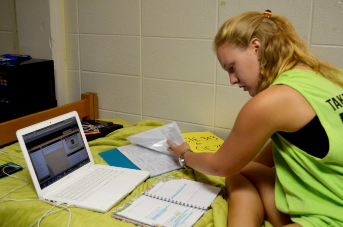 "Senior elementary education major, Amy Fairbank, takes time on a Sunday morning to plan her week ahead.  ""It's easier to keep track of my schoolwork if I take time to plan everything out at the beginning of each week,"" she says. 