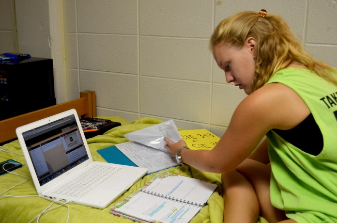 """Senior elementary education major, Amy Fairbank, takes time on a Sunday morning to plan her week ahead.  """"It's easier to keep track of my schoolwork if I take time to plan everything out at the beginning of each week,"""" she says. 