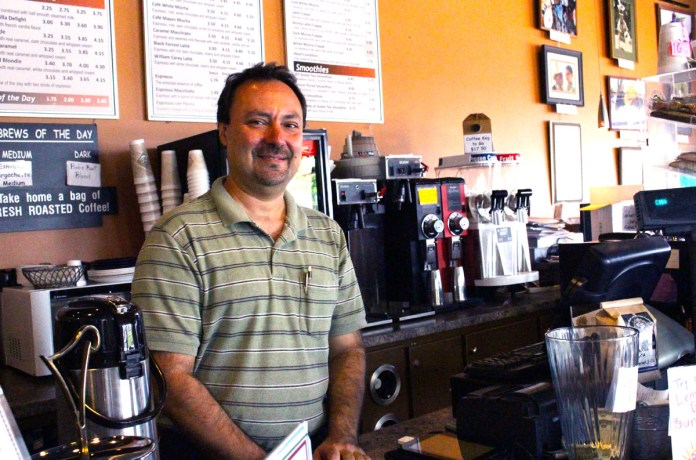 Cesar Potenza, owner of Java Werks, has been with the new coffee shop since the reopening in April 2013. Java Werks is a convietly located on Hardy St. across from campus. | Photo by Abby Smith