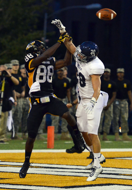 Southern Miss wide receiver Michael Thomas fails to catch the football while defended by Rice safety Cole Thomas in Saturday's game at M.M. Roberts Stadium. -Kara Davidson