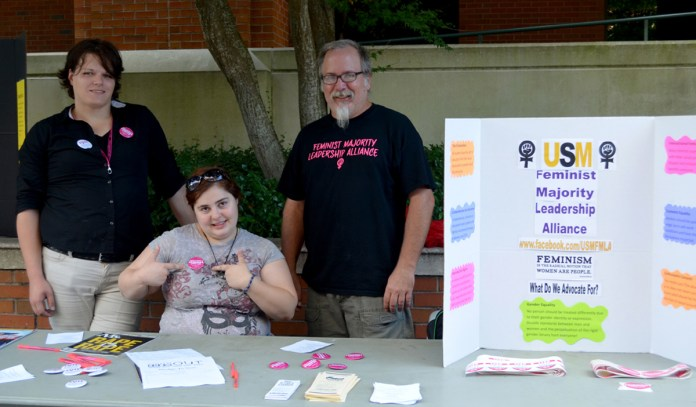 Seniors Lisa Wakeland and Savana Blohm and Community Advisor Jamie Stuart of the USM Feminist Majority Leadership Alliance promote their club on Tuesday outside the library.  On this day, members invited new students to join the club and promoted information about their work for intersectional feminism at USM and in the state of Mississippi.