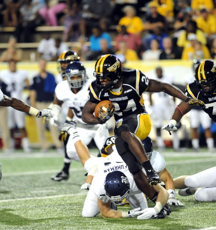 Running back George Payne pulls away from the Rice defense during Southern Miss' first conference game of the season Sat. 27th, 2014 at the Rock. - Susan Broadbridge