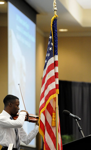 Violinist, John Uzodinma performs the National Anthem at the 9th Annual Dr. Martin Luther King Jr. Interracial and Ecumenical Prayer Breakfast held in the Thad Cochran Center in Hattiesburg, MS. Monday, Jan. 19, 2015.