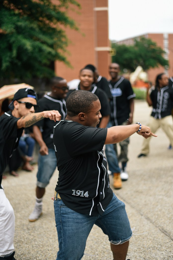 Anthony McNair leads the Theta Eta chapter of Phi Beta Sigma Fraternity, Inc in a stroll at Coolin' With the Zetas back to school social, Wednesday August 19, 2015, which is the first NPHC event held this 2015-16 school year. Courtland Wells/ Student Printz