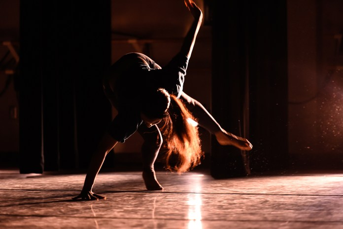 Gabrielle Slack dances in 'tread away' choreographed by Taylor Krupp during the Hub Dance Collective's 'In The Groove' presented on Friday, August 21, 2015. This was the third annual Hub Dance Collective concert.