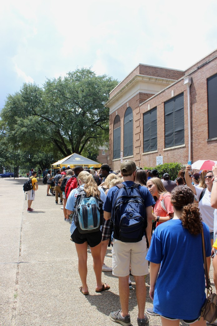Eagle Club member bypass the line to receive tickets to the Southern Miss vs. Mississippi State football game Friday Morning, August 21, 2015. Southern Miss is scheduled to play Mississippi State September 5th at home. Beth Cunningham/Student Printz