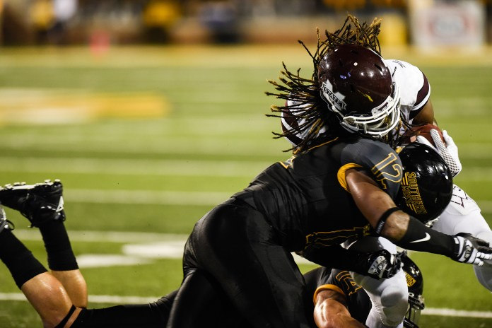 D'nerius Antoine tackles a Mississippi State running back during the Southern Miss opener September 5, 2015. Courtland Wells/Student Printz