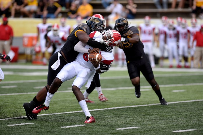 Dylan Bradley sacks Austin Peay's quarterback during the second game of the season. The Golden Eagles won against the Governors 52-6 Sept 12, 2015.