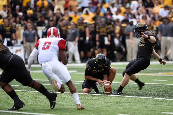Stephen Brauchle attempts a field goal against Austin Peay. The Golden Eagles won against the Governors 52-6 Sept 12, 2015.