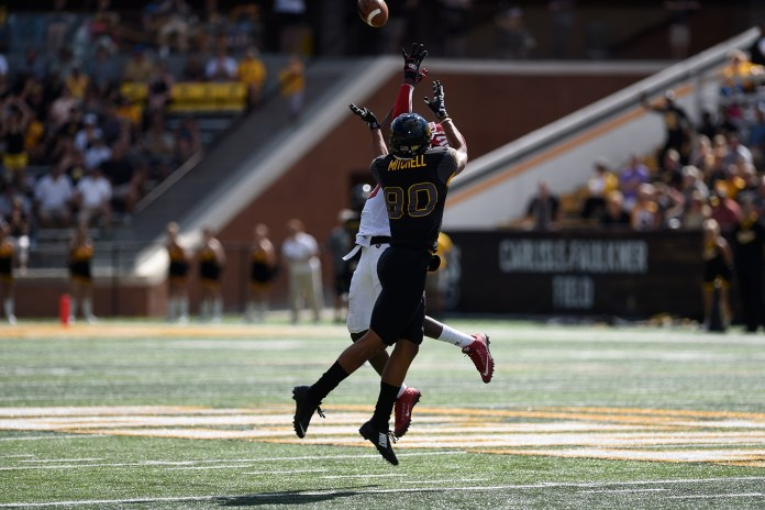 Jordan Mitchell goes up for a pass with an Austin Peay defender. The Golden Eagles won against the Governors 52-6 Sept 12, 2015.