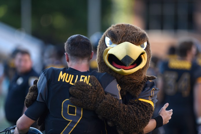 Nick Mullens hugs with Seymour after the victory against Austin Peay. The Golden Eagles won against the Governors 52-6 Sept 12, 2015.