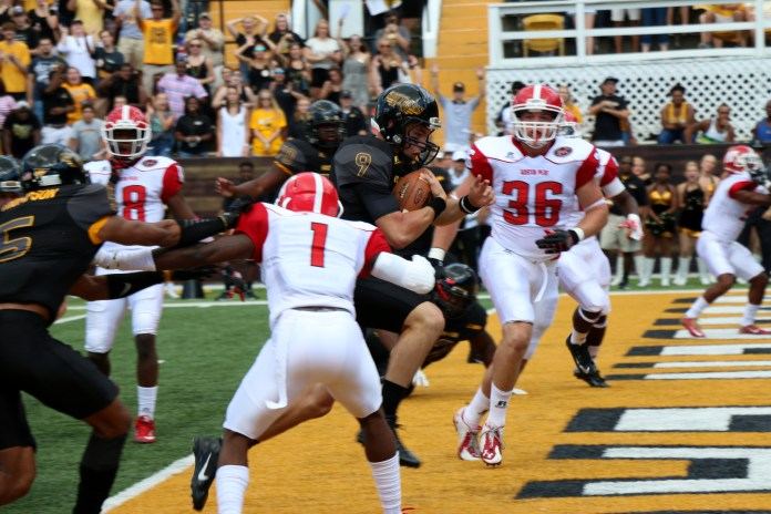 Nick Mullens runs the ball for a touchdown against Austin Peay. The Golden Eagles won 52-6 against the Governors Sept 12, 2015.