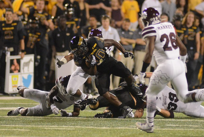 Southern Miss running back Jalen Richard powers through Mississippi State defense during the game played in Hattiesburg on Saturday night.  Mary Alice Weeks/Student Printz