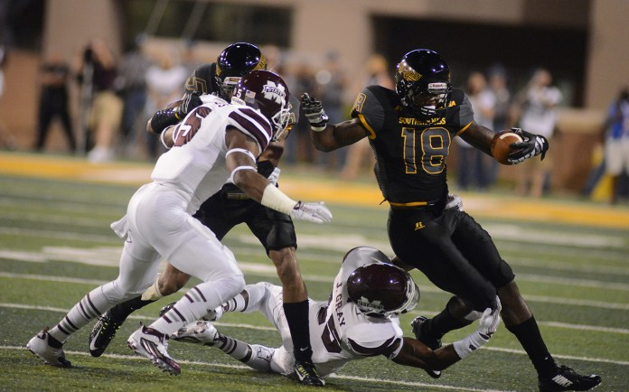 Southern Miss receiver Korey Robertson avoids Mississippi Sate defense during the game played in Hattiesburg on Saturday night.  Mary Alice Weeks/Student Printz
