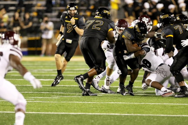 Southern Miss running back Jalen Richard running through Mississippi State players in Hattiesburg on Saturday night.