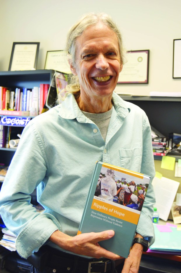 Political science professor ,Dr. Bob Press and his book 'Ripples of Hope - How ordinary people resist repression without violence.' Monday, Sept. 28th 2015. Jillian Rodriguez / Student Printz