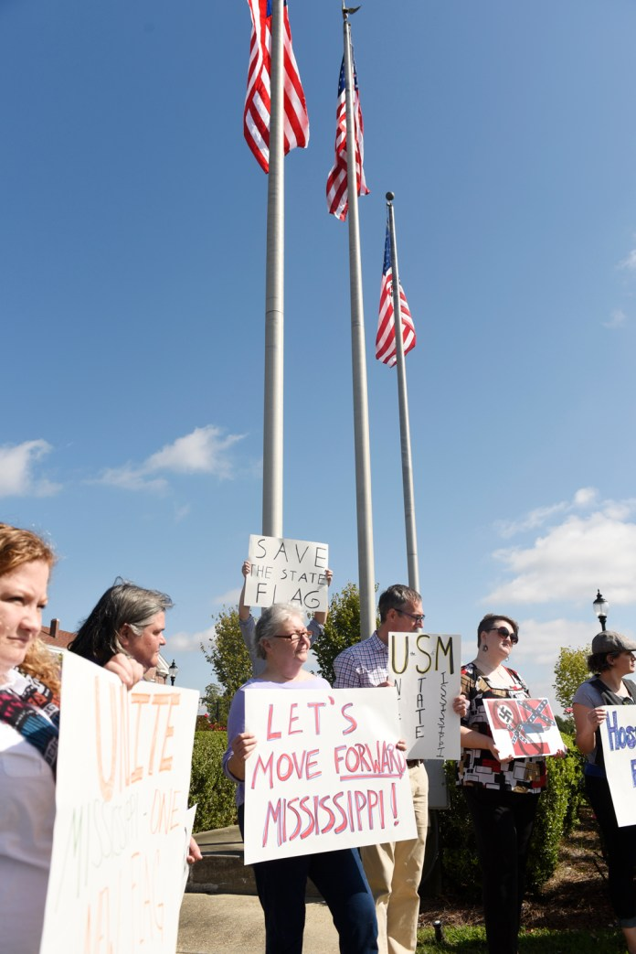 Isaac Hitt, a supporter of the Mississippi flag, meets with demonstrators against the Mississippi flag on the campus of the University of Southern Mississippi on Oct 28, 2015. The University of Southern Mississippi becomes the second University in Mississippi to remove the flag from the campus. Courtland Wells/Student Printz