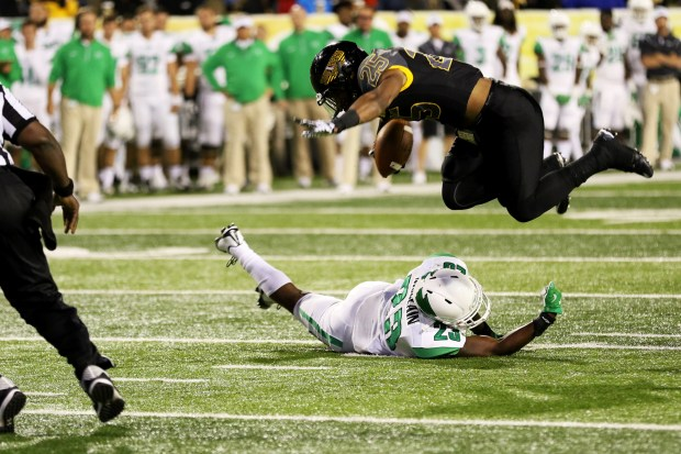 Southern Miss running back Ito Smith dodges a North Texas player on Saturday night in Hattiesburg, Mississippi on October 3, 2015. (Student Printz/ Hunt Mercier)