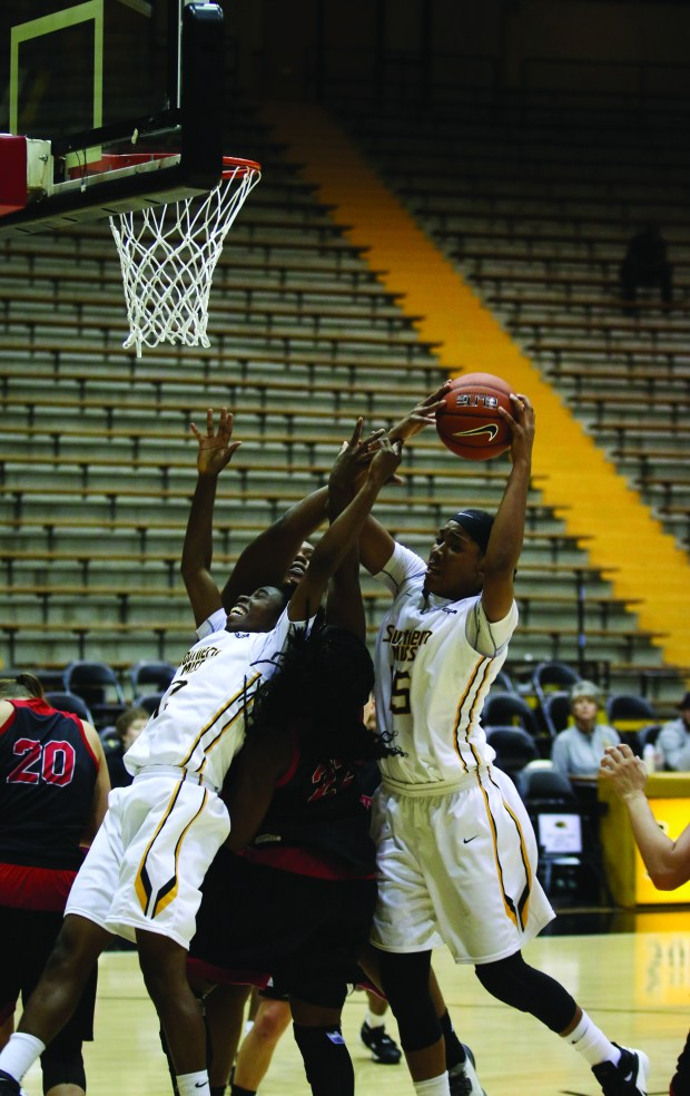 Southern Miss Lady Golden Eagles Caitlin Jenkins (15) drives to the basket against West Alabama.
